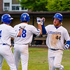 Jackson Coutts (44) is congratulated by Matthew Koperniak (18) and James Ciliento (4) after scoring a run in the fifth inning.