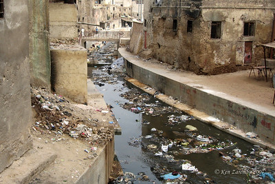 The garbage is thrown directly into the river from the walking bridge in the Medina of Fez