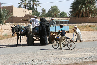 Berber women catching  bus, a typical means of transportation for rural women as is their dress