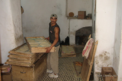 Moroccan women make their dough at home, then bring it to the town baker for baking