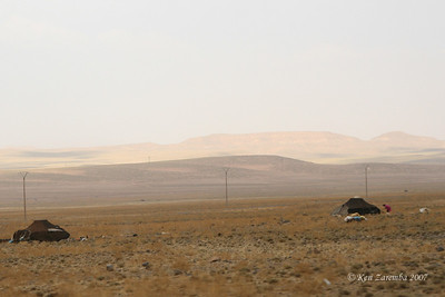 2 family Berber nomad encampments in the sub Saharan - dunes in background