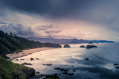 Indian Beach sits at the base of Tillamook Head's southern slope in Ecola State Park, and it is an ideal place to take in the enormity of the basalt formation that displays the region's geological heritage.  If the tumultuous and vast Pacific doesn't inspire sufficient awe, consider the prospect that some 15 million years ago the rock that forms the Tillamook Headland was a molten river of basalt flowing down the Columbia Gorge from Idaho.