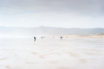 People on Beach on a cloudy day.