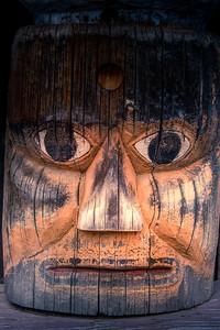 Totem pole details Ksan Historical Village Hazelton British Columbia photo