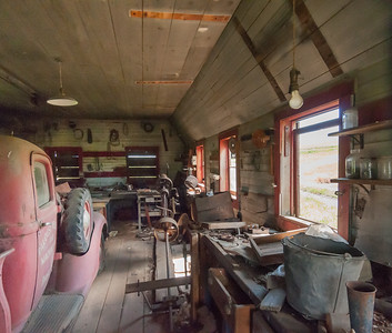 Old garage with Dodge ram truck. The years of dust collecting on the vechicle is visible.