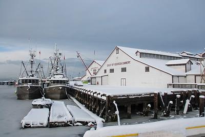 Snow covers the docks in Steveston harbour