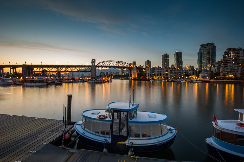 Early evening in false creek with seabus boats in fore ground.