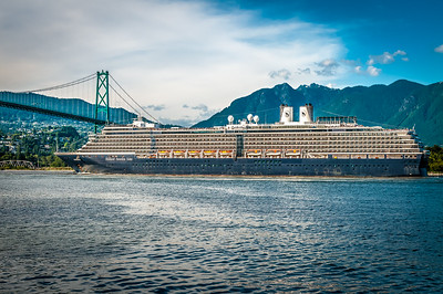 Cruise ship leaving Vancouver harbour and going under the Lions Gate bridge.