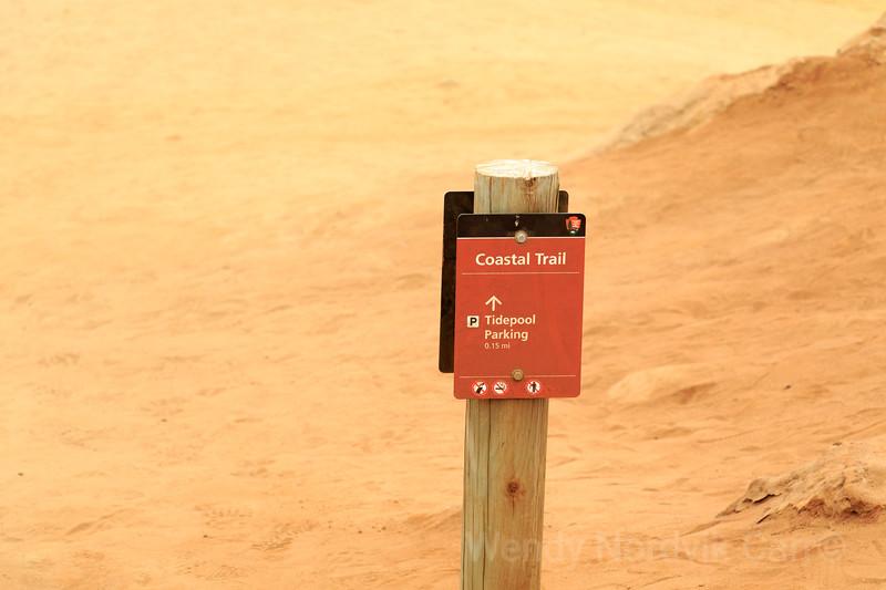 Coastal Trail signage along the eroding sandstone cliffs on the  stunning southern California coastline