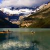 Lake Louise, Banff National Park: As we eat our al fresco breakfast on the boardwalk, we're entertained by boaters on Lake Louise.  The lake's milky-green color is starting to become evident.