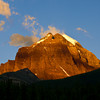 As the sun rises slowly, the summits of the mountains along the TransCanada Highway turn golden.
