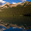 Mount Whyte, Big Beehive, Mount Niblock, and Mount Piran reflected in the calm waters of Lake Louise.