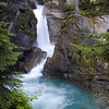 """Lower Falls in Johnston Canyon consists of two cataracts. This quote from Wallace Stegner seems most appropriate: """"I gave my heart to the mountains the minute I stood beside this river with its spray in my face and watched it thunder into foam ..."""" (The Sound of Mountain Water)."""