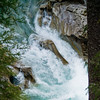 The fast-flowing water heeds no obstacle as it crashes on and around boulders in its way.