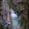 Johnston Canyon is the result of 8,000 years of erosion; and the process is far from over.  Not only is fast-flowing Johnston Creek continuing to gnaw away at the canyon walls, but the slightly acidic creek water is slowly dissolving the limestone through which it flows.