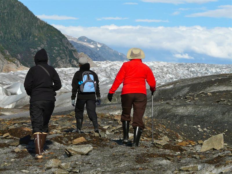 Three people walking on Baird Glacier