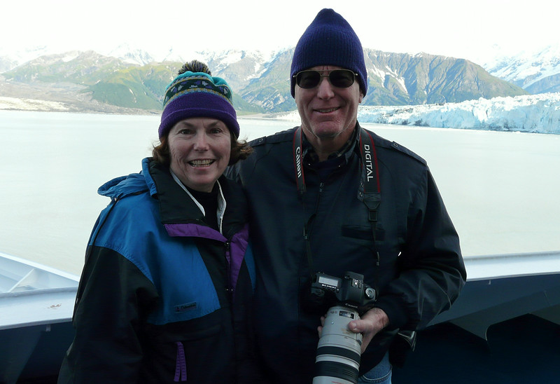 Two boomer travelers enjoying the view on a luxury cruise in Alaska. #boomertravel #Alaska