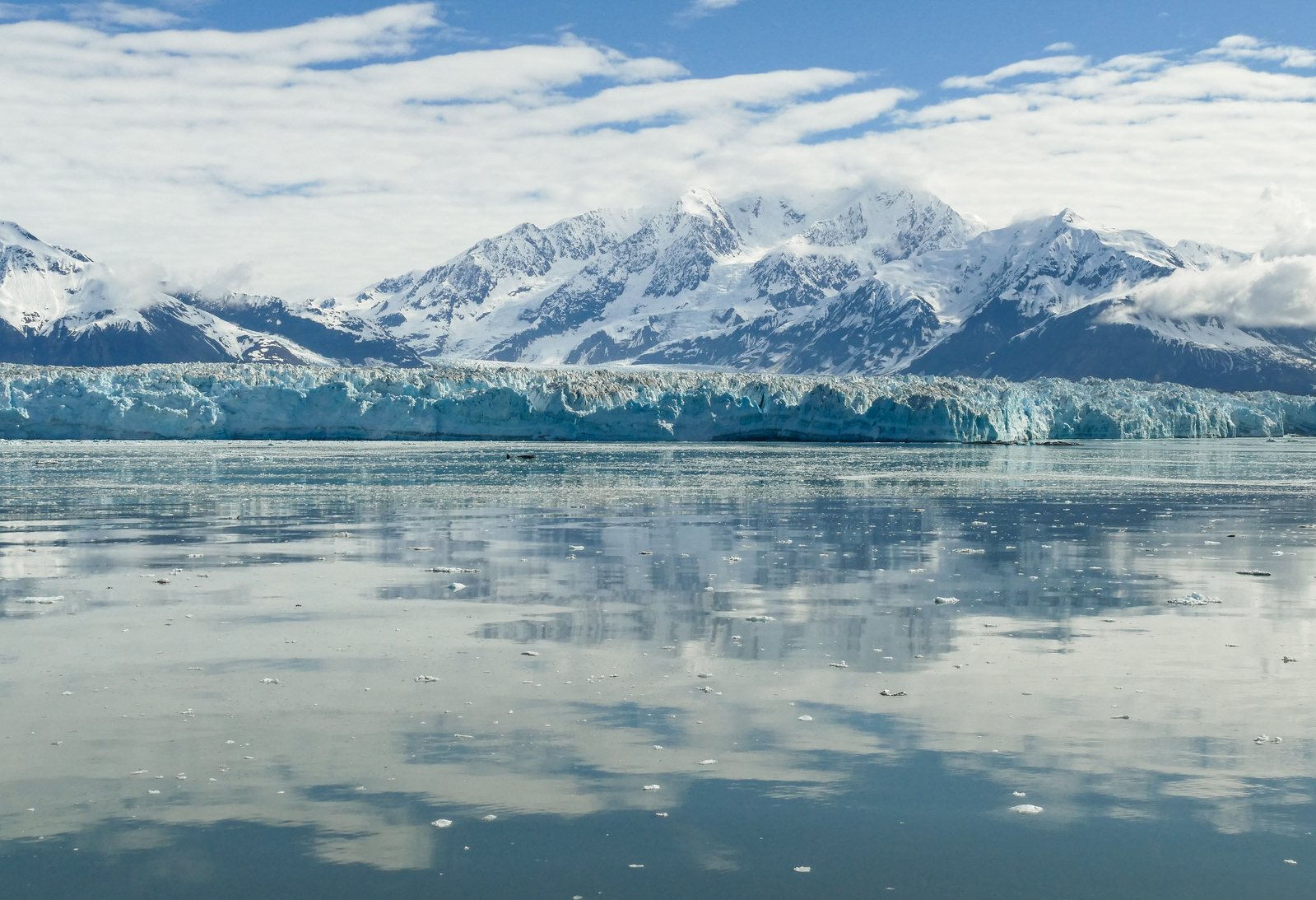 Hubbard Glacier reflected in the waters of Disenchantment Bay, Alaska.