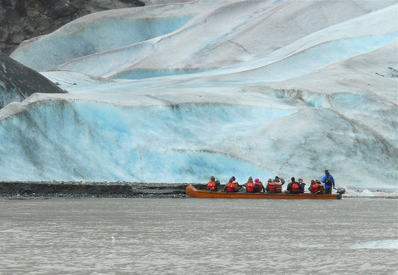 Canoes motor close to the face of Alaska's Davidson Glacier. It's a fun cruise excursion when your ship calls on Skagway.