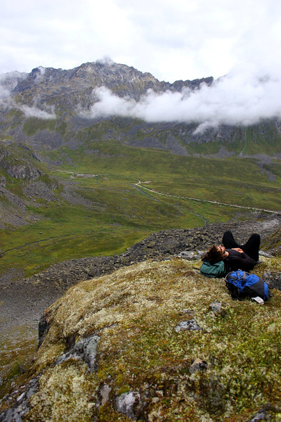 It was a steep slog up the mountainside so we definitely needed some breaks. The clouds were constantly changing. Dane enjoys a few moments rest.