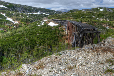 An old bridge passed by the White Pass Train Station route in Alaska
