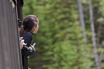 A woman peeks out of the White Pass Train in Skagway, Alaska
