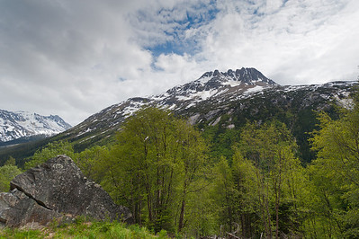 Snow-covered peaks along the White Pass Train route in Skagway, Alaska