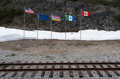 Flags along the route of White Pass Train in Alaska
