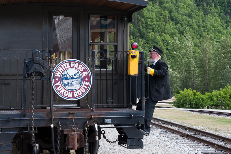 Steam conductor getting into the White Pass Train in Skagway, Alaska