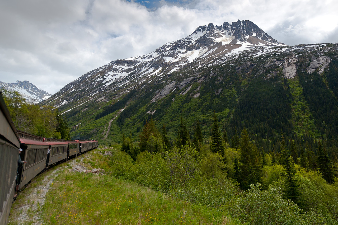 View of snow-covered peaks from White Pass Train in Skagway, Alaska