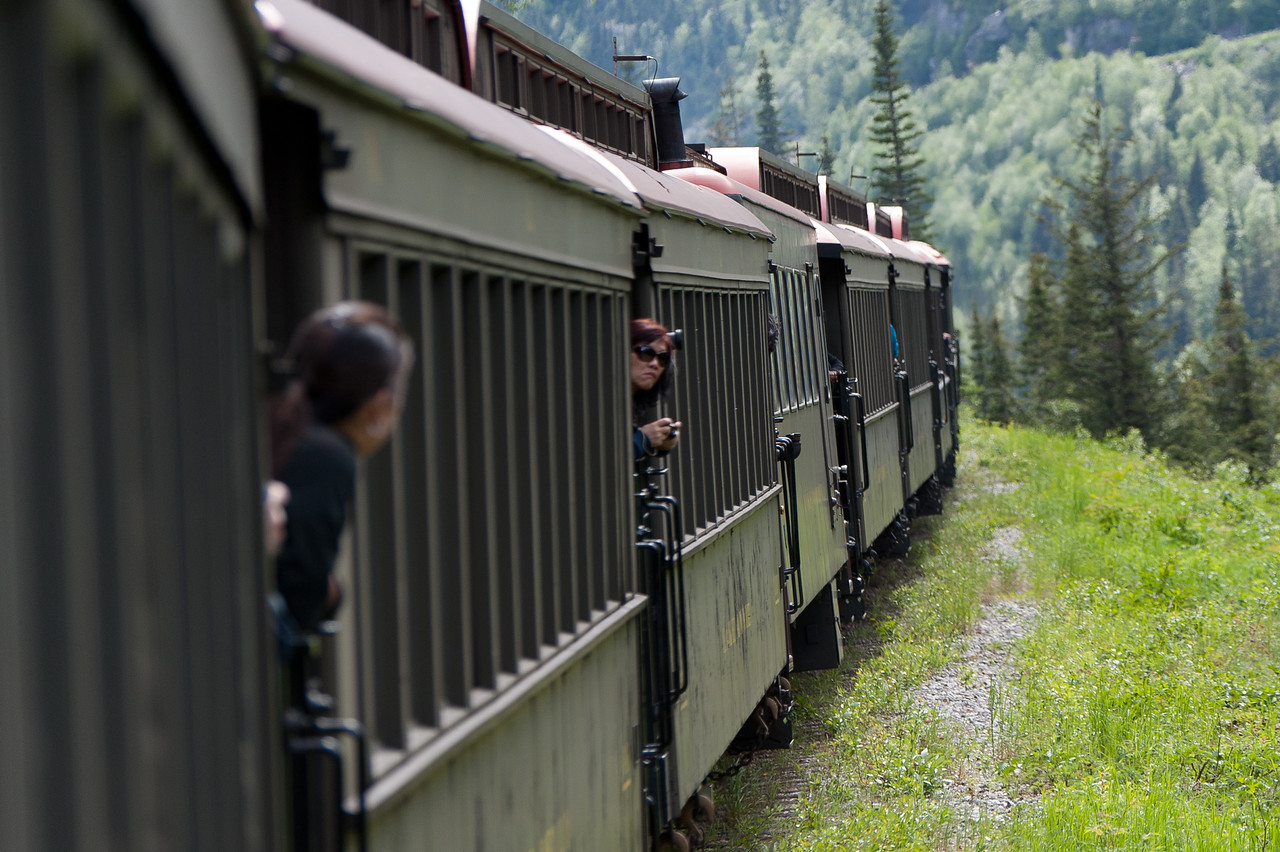 Tourists peeking out from the White Pass Train in Skagway, Alaska