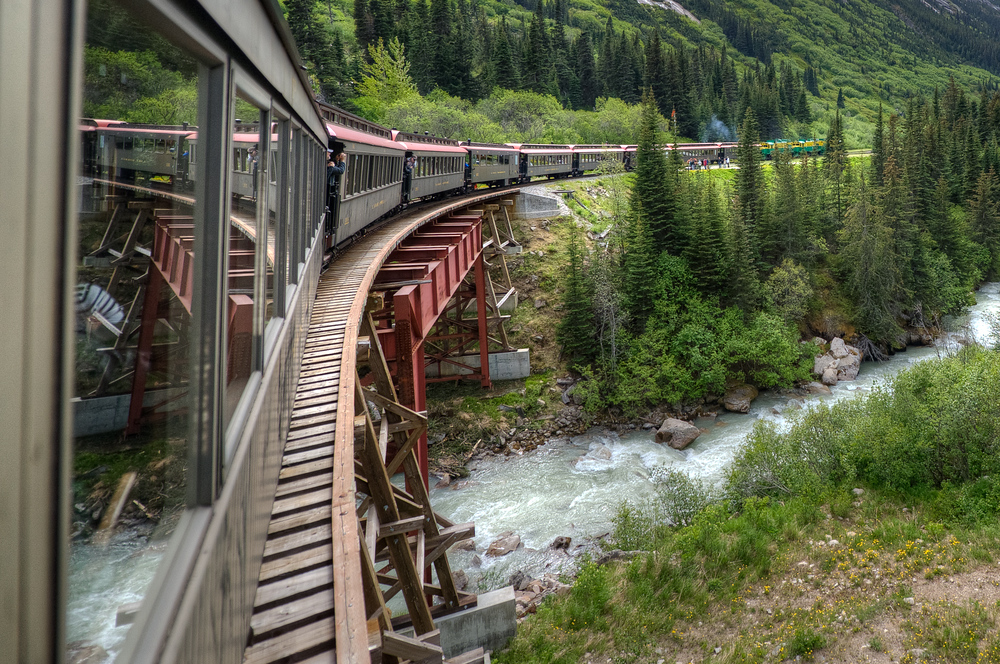 Train going around a bend near Skagway, Alaska