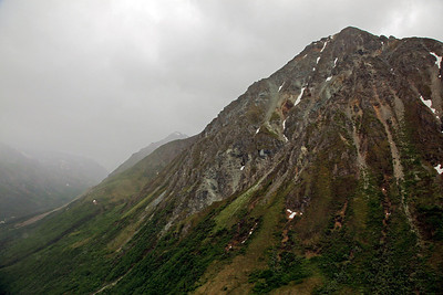 Denali, Alaska Skipping along underneath the cloud cover, we pass some beautiful mountain peaks.