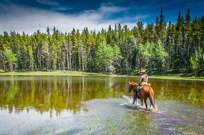 Man on horseback in Anchor D Ranch, Canada