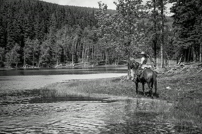 Man on horseback in Anchor D Ranch, Alberta, Canada