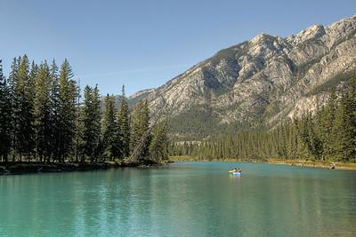 Solitary boat in Moraine Lake in the Canadian Rockies of Alberta, Canada
