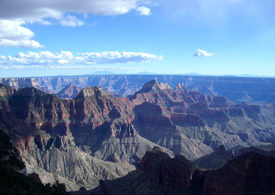 Looking in to the Grand Canyon with blue sky overhead.