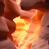 A golden light illuminates the walls of Lower Antelope Canyon near Page, Arizona
