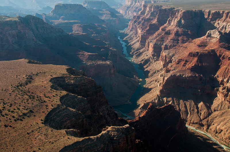 Overlooking view of Colorado River winding through the Grand Canyon