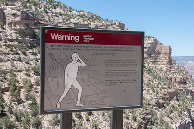 Warning sign for hikers at the Grand Canyon National Park in Arizona, USA