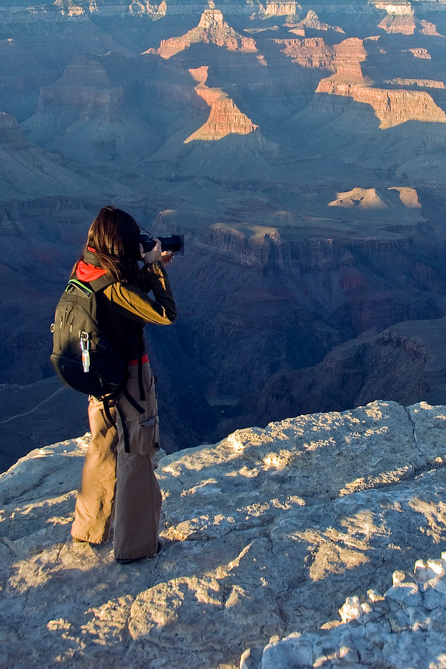 Tourist taking photos of Grand Canyon National Park - Arizona, USA