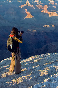 Tourist taking photos of Grand Canyon National Park - Arizona, USA