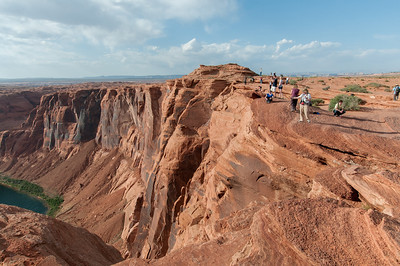 Tourists checking out Horseshoe Bend in Lake Powell, Arizona