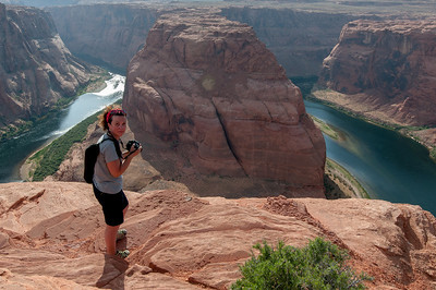 Tourist taking a photo of the Horseshoe Bend in Lake Powell, Arizona, USA