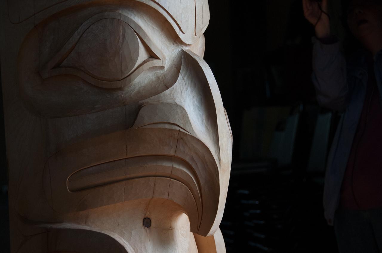 Close-up shot of totem pole in Haida Gwaii, British Columbia
