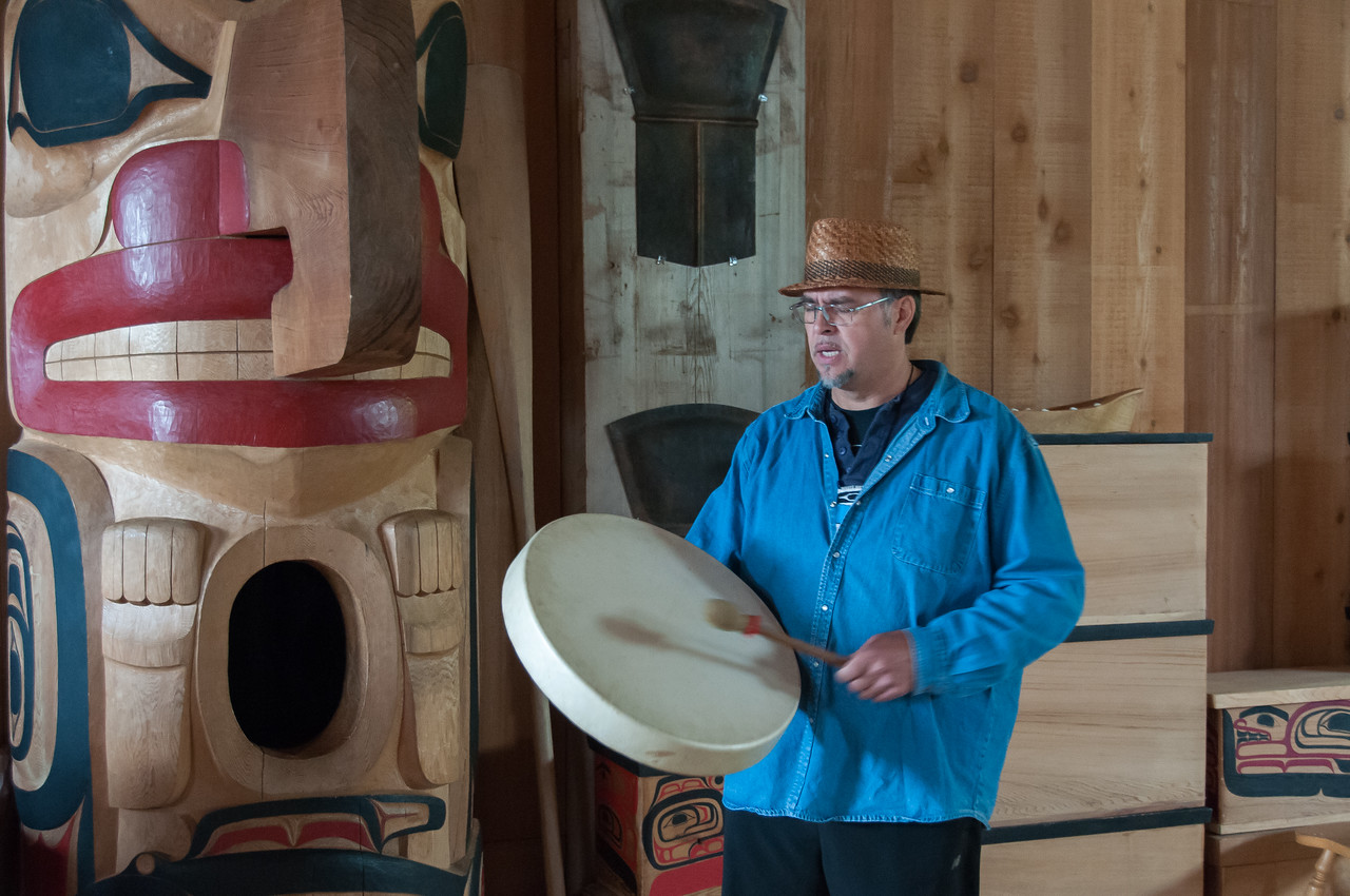 Man carrying native Indian instruments at Haida Heritage Center in British Columbia