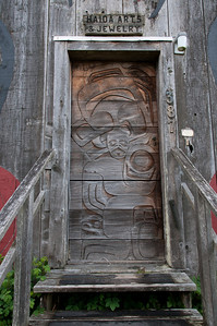Carvings on the door at Haida Arts & Jewelry shop in Skidegate, British Columbia