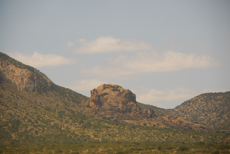 A huge boulder in the California desert as seen from the Amtrak