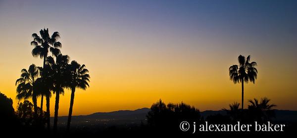 Sunrise over LA from window of hotel room at Langham Huntington Pasadena Hotel Pano