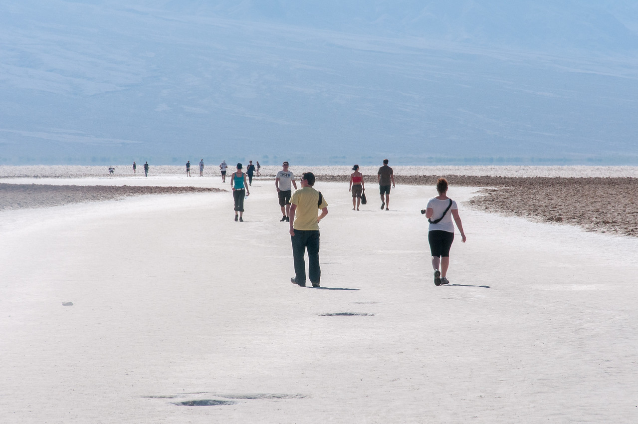 Tourists exploring Badwater Basin in Death Valley National Park